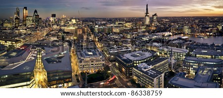 London at twilight panoramic view from St. Paul\'s Cathedral. This view includes Tower 42 Gherkin,Willis Building, Stock Exchange Tower, Canary Wharf,  Tower Bridge and a construction of Shard Lo