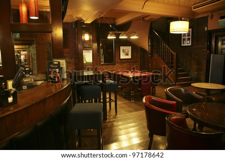LONDON AUG 30 Interior of pub for drinking and socializing focal point of the community on Aug 30 2010 London UK Pub business now about 53 500 pubs in the UK has been declining every year