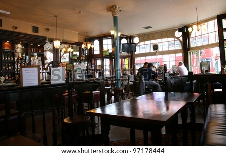 LONDON - AUG 3: Interior of pub, for drinking and socializing, focal point of the community, on Aug 3, 2010, London, UK. Pub business, now about 53,500 pubs in the UK, has been declining every year