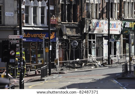 LONDON - AUGUST 09: Clapham Junction area is sacked after the third night of riots, on August 09, 2011 in London. Riots start spreading in London after Mark Duggan was shot dead by the police.