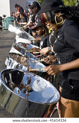LONDON - AUGUST 29: Steel-drummer from CIS Band Trust playing steel drums at the Notting Hill Panorama Championships on August 29, 2009 in Hyde Park, London, England.