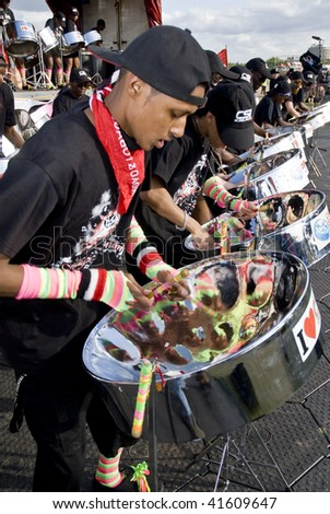 LONDON – AUGUST 29: Steel-drummers from the CIS Band Trust play steel drums at the Notting Hill Panorama Championships on August 29, 2009 in Hyde Park, London, England.
