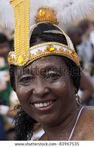 LONDON - AUGUST 29: Unidentified old Jamaican woman in carnival headdress, smile at cameras during the Notting Hill Carnival on August 29, 2011 in Notting Hill, London, England.