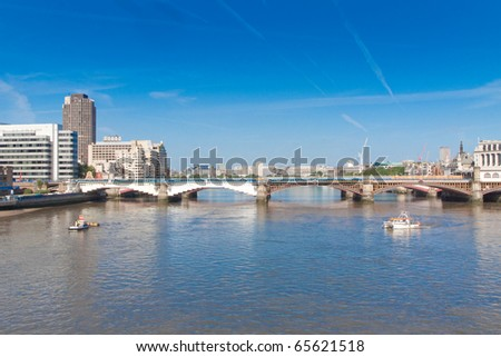 London bridge over River Thames on bright sunny day