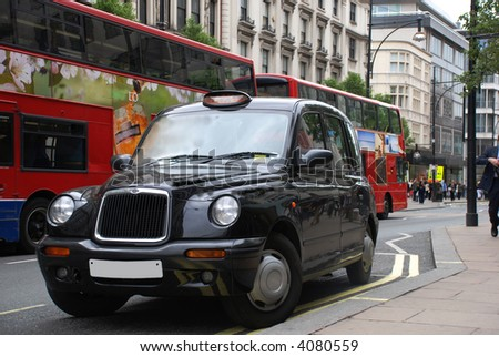 London cab abd busses on street