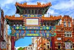 London Chinatown entrance gate in traditional chinese design, England, United Kingdom.