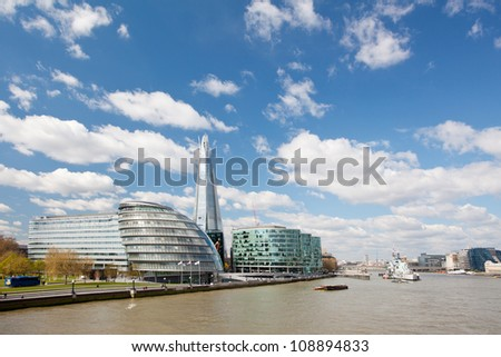 London City Hall Skylines along River Thames against blue sky, England UK