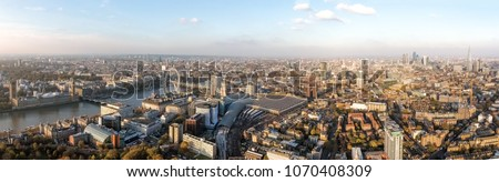London Cityscape Aerial Panorama View feat. Houses of Parliament in Westminster on Thames River, Famous British Landmarks Skyline with Wide Panoramic Birds Eye View in England, United Kingdom UK