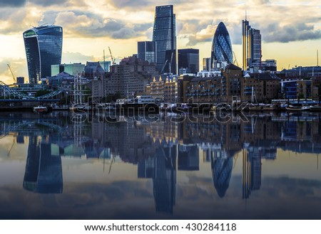 London cityscape during sunset with its reflection from river Thames