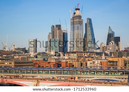 London cityscape with Blackfriars traffic and railway bridges on a cloudless day