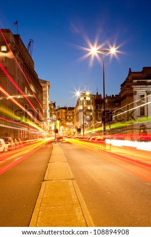 London Cityscape with Road Light Trail at dusk using for City Lifestyle transportation