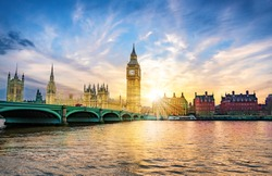 London cityscape with the Big Ben and City of Westminster Abbey bridge in sunset light, in United Kingdom of England