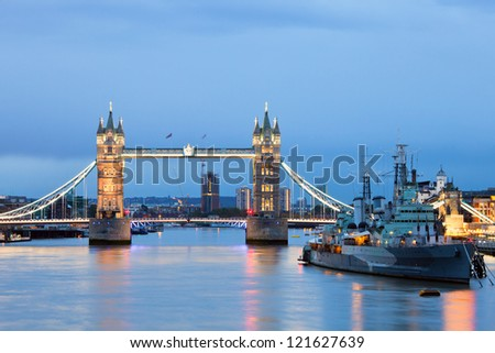 London cityscape with Tower Bridge and HMS Belfast at dusk