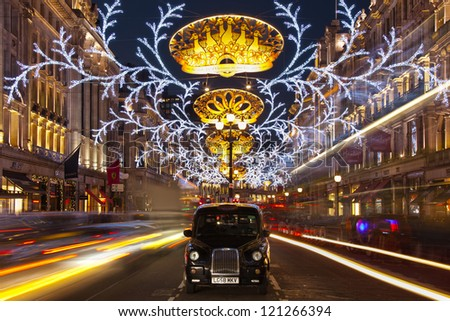 LONDON - DECEMBER 8: Christmas lights on Regent street, the busiest shopping area, on December 8, 2012 in London, England