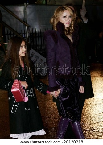 LONDON - DECEMBER 6: Singer Madonna and daughter Lourdes attends the red carpet premiere of Harry Potter  December 6, 2005 in London, England.
