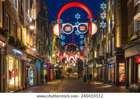 LONDON - DECEMBER 29th 2014: Christmas lights on Carnaby Street, London UK. Carnaby Christmas lights feature some of the most unusual Christmas decorations and lights in London.