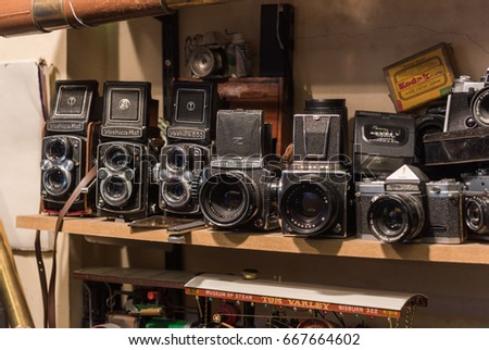 london, england, 10/05//2017 An old bronica, kiev, yashica and pentax retro vintage film photography camera collection, on a shelf in an old antique shop. #667664602
