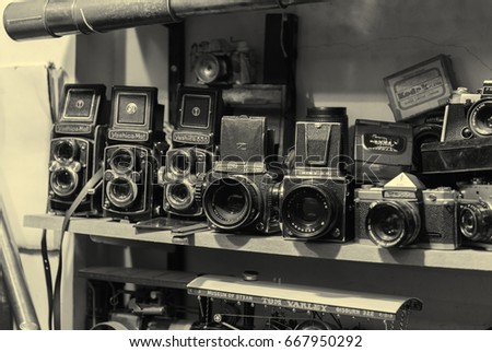 london, england, 10/05//2017 An old bronica, kiev, yashica and pentax retro vintage film photography camera collection, on a shelf in an old antique shop. #667950292