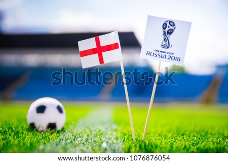 LONDON, ENGLAND - APRIL, 24, 2018: England national flag and Official logo of Football FIFA World Cup 2018 in Russia. #1076876054