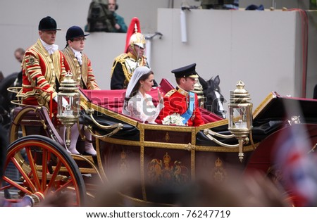 stock photo : LONDON, ENGLAND - APRIL 29: Prince William and his bride, Catherine Middleton, arrive in a coach at The Mall on the afternoon of their marriage on April 29, 2011 in London England.