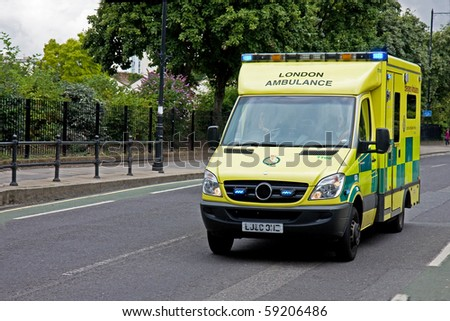 LONDON, ENGLAND - AUGUST 14: Emergency Ambulance speeds along street in London in response to an emergency call on August 14, 2010 in London.