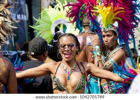 London/England - August 28 2017: Performers take part on Notting Hill Carnival, largest in Europe #1042705789