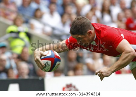 LONDON, ENGLAND. 06 AUGUST 2011. Shane Williams, playing for Wales  during the rugby union Investec International between England and Wales at Twickenham Stadium.