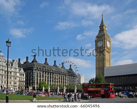 LONDON, ENGLAND - Big Ben with double-decker bus in foreground and London Eye in background. - stock photo