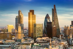 London, England - Business district with famous skyscrapers and landmarks at golden hour