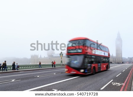 LONDON, ENGLAND - DECEMBER 17: Red London bus on Westminster Bridge. In London, England. On 17th December 2016.