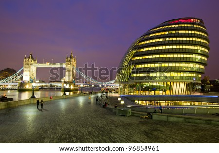 LONDON, ENGLAND FEB 17: London City Hall, headquarter of London Authority and Tower Bridge on Feb 17, 2012 in London, United Kingdom.