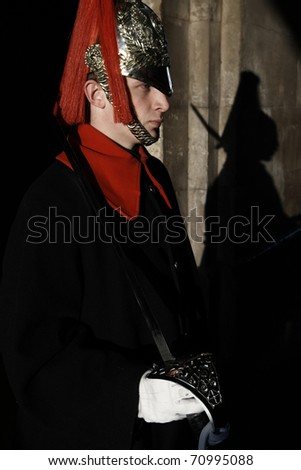 LONDON, ENGLAND - FEBRUARY 21: Member of the Royal Horse Guards on sentry in front of the palace in February 21, 2009 in London, United Kingdom.