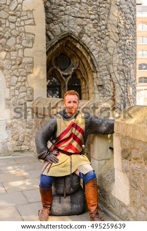 LONDON, ENGLAND - JUL 20, 2016: Unidentified man at the Tower of London (Her Majesty's Royal Palace and Fortress of the Tower of London)
