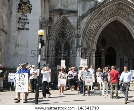 LONDON, ENGLAND - JULY 19; Supporters for Dr Kelly who was killed in suspicious circumstances outside the Royal Courts of Justice on July 19, 2013. Many of the protesters had mouths taped.