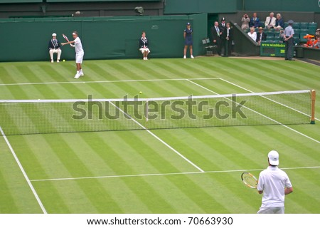 LONDON, ENGLAND - JUNE 26: Rodger Federer plays Richard Gasquet in the first round of tennis at Wimbledon on June 26, 2006 in London, England. Federer goes onto win the match and the Wimbledon Title. - stock photo