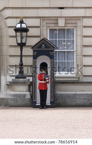 LONDON, ENGLAND- JUNE 21: Sentry of the Grenadier Guards posted outside of Buckingham Palace on June 21, 2009 in London, United Kingdom.  The Grenadier Guards traces its lineage back to the year 1656.