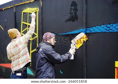 LONDON, ENGLAND -12 MARCH 2015- Editorial: Graffiti street artists are busy at work spray painting walls in the Old Street, Brick Lane and Shoreditch area in East London in the heart of Banglatown.
