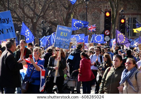 LONDON, ENGLAND - 25 MARCH 2017: Protesters rally against Brexit in front of parliament in London, England. The UK has stated its intention to begin withdrawal from the EU on 29 March 2017. Editorial.