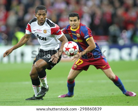 LONDON, ENGLAND. May 28 2011: Manchester\'s midfielder Antonio Valencia and Barcelona\'s midfielder Pedro Rodreguez during the 2011UEFA Champions League final between Manchester United and FC Barcelona