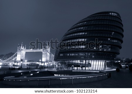LONDON, ENGLAND NOV 7: London City Hall, headquarter of London Authority and Tower Bridge on November 7, 2011 in London, United Kingdom.