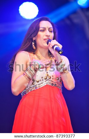 LONDON, ENGLAND - OCTOBER 16: Celebrity Indian singer Shivali Brammer performs live on stage at the Diwali Festival of Light in Trafalgar Square on October 16, 2011 in London, England.. - stock photo