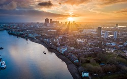London, England - Panoramic aerial skyline view of east London at sunrise with skycrapers of Canary Wharf and beutiful colorful sky at background