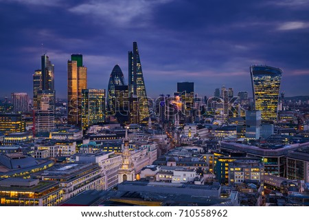 London, England - Panoramic skyline view of Bank district of London with the skyscrapers of Canary Wharf at the background at blue hour #710558962