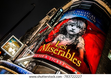 "London, England. 23rd December 2017. EDITORIAL - Low angle view of the large illuminated display for the ""Les Miserables"" musical outside the Queen's Theatre in London, UK."