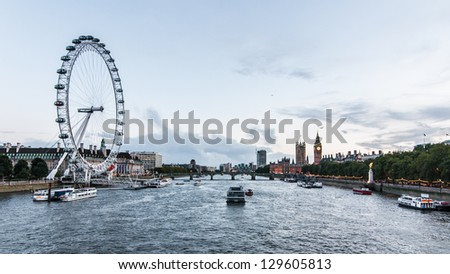 LONDON, ENGLAND - SEPTEMBER 26: Panoramic view of London Eye, County Hall, Westminster Bridge, Big Ben and Houses of Parliament after rain storm on September 26th 2012 in London.