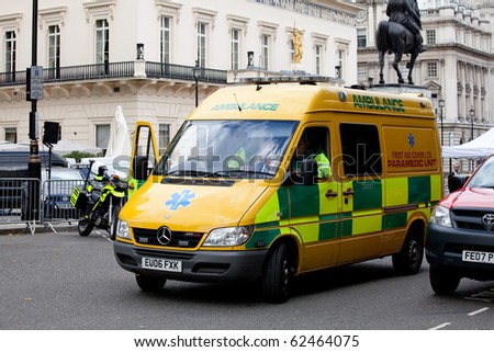 LONDON, ENGLAND - SEPTEMBER 15: Paramedics wait in parked Emergency Ambulance for call on 15 September 2010. Part of preparation for Pope's visit to London.