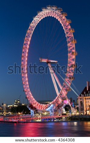 London Eye at the evening in London with reflection on water. Motion