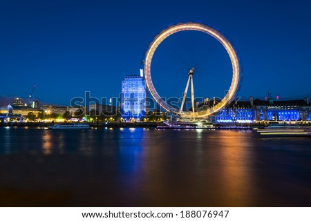 London Eye. London, United Kingdom - April 18, 2014: London, UK, skyline in the evening. London Eye is a famous tourist attraction at a height of 443 ft it is the biggest Ferris wheel in Europe.