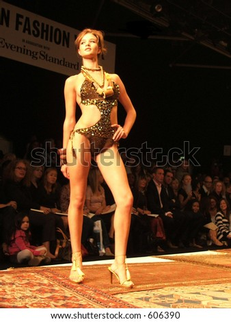 London Fashion Week Spring/ Summer 2006. A piece from  Julien McDonald collection. Model Rosie Huntington-Whiteley.
