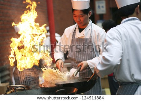 LONDON FEB 18 Chinese chefs working at Chinese New Year celebrations in London's Chinatown on Feb18 2007 London UK Various traditional performance attract thousands of people to the street